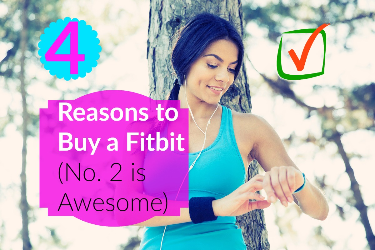 woman using fitbit outdoors