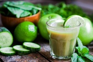 Green smoothie with,spinach,cucumber,lime