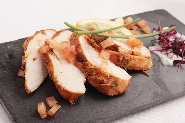 sliced cold chicken on the plate